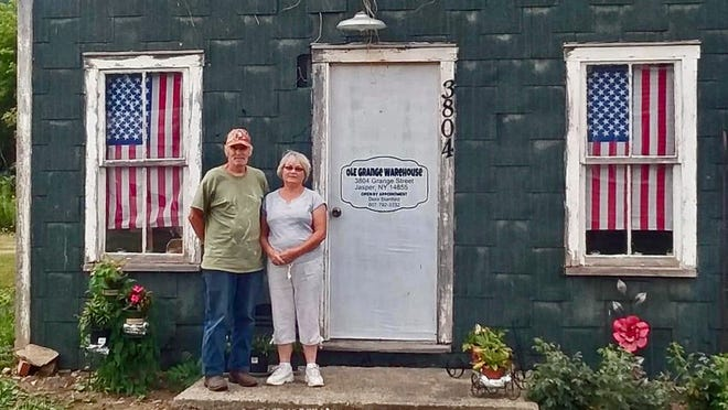 Jim and Dora Stanford stand outside of their antique store, Stanford's Ole Grange Warehouse in Jasper. The couple recently did extensive renovations on the historic former Grange building.