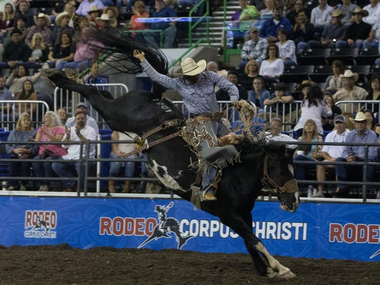Saddle bronc rider Leon Fountain competes on the first night of the Corpus Christi Rodeo at the American Bank Center on Thursday, April 27, 2017.