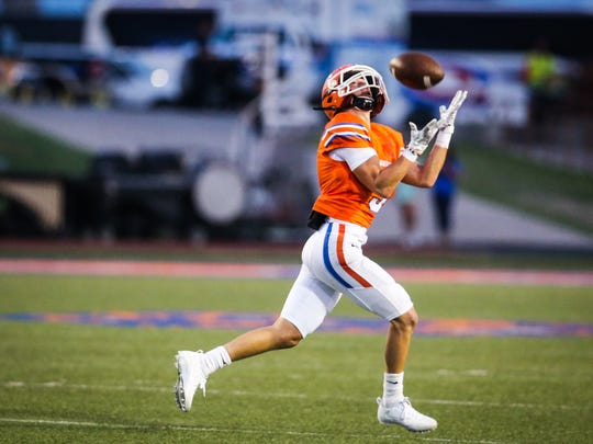 Central's Gage Smith attempts to catch the pass during the game against Kerrville Tivy Friday, Sept. 15, 2017, at San Angelo Stadium.