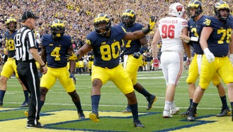 Michigan Wolverines fullback Khalid Hill (80) celebrates a touchdown during the second quarter against the Wisconsin Badgers.