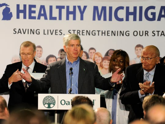 Gov. Rick Snyder promotes the Healthy Michigan program at Oakwood Hospital in Dearborn in 2013.