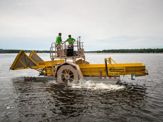 Underwater Solutions has cut approximately 450,000 pounds of curly-leaf pondweed with an aquatic weed harvesting boat this spring in East Okoboji Lake, Wednesday, June 14, 2017.