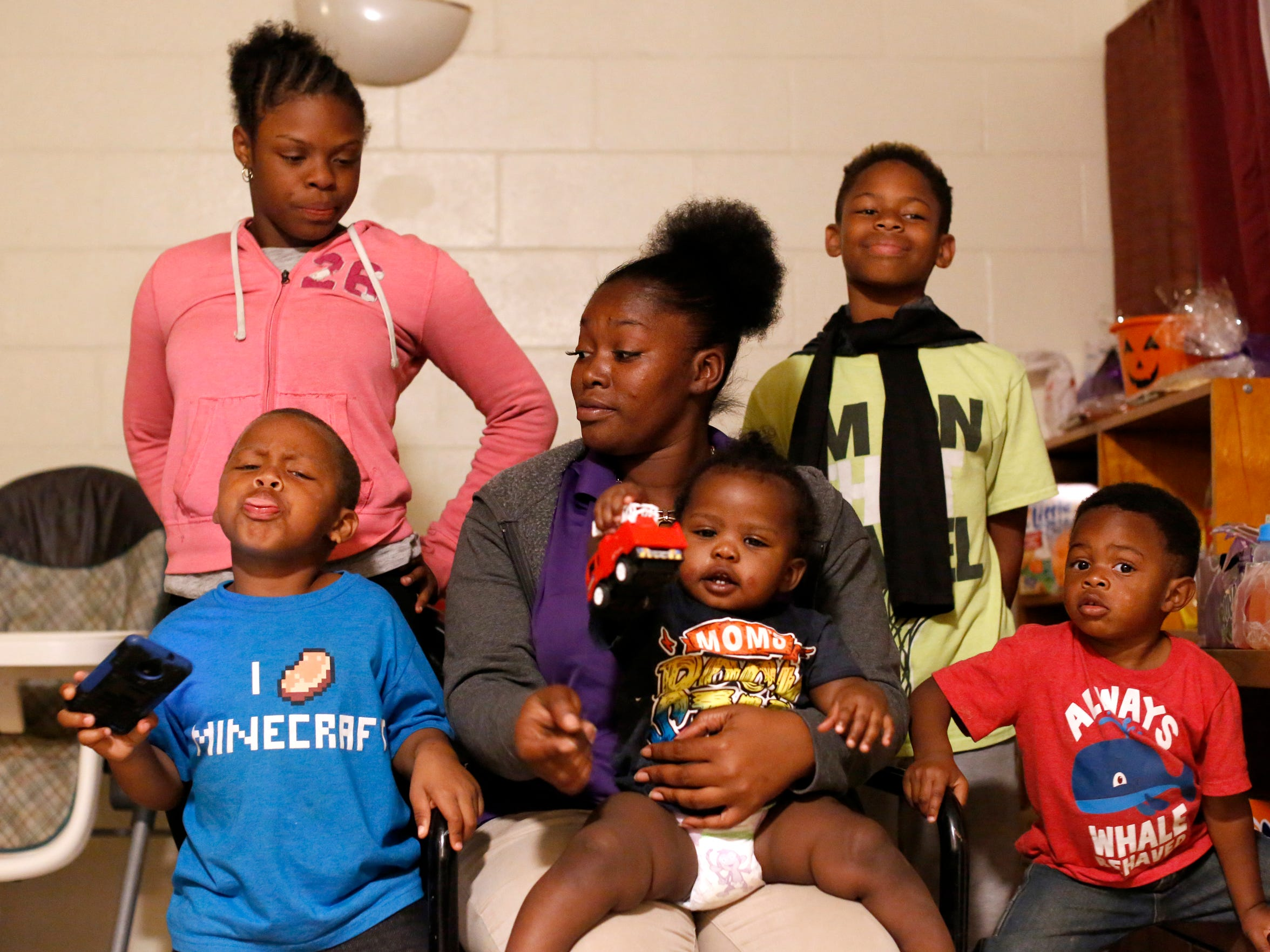Porsche Robinson and her five children pose for a portrait at the family's apartment Nov 15. Robinson was reunited with her children in April after her case went through the newly-established Early Childhood Court.