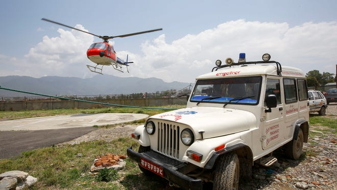 A helicopter lands with the body of deceased Dutch climber Eric Arnold at the helipad at Teaching Hospital in Kathmandu, Nepal, 26 May 2016.