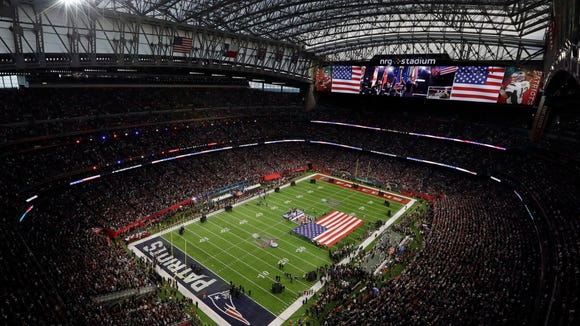 The American Flag is displayed on the field as Luke Bryan sings the national anthem before the NFL Super Bowl 51 football game between the Atlanta Falcons and the New England Patriots Sunday, Feb. 5, 2017, in Houston. (AP Photo/Morry Gash) ORG XMIT: NFL126