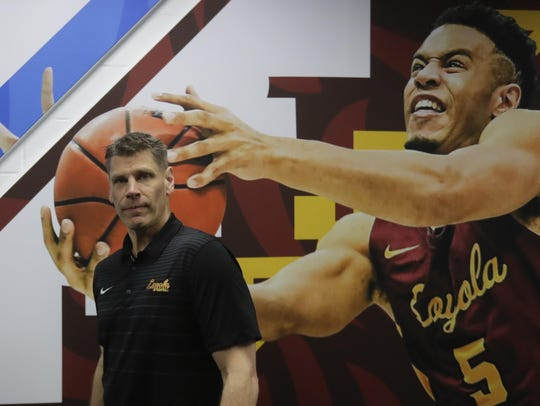 Loyola-Chicago head coach Porter Moser walks past a