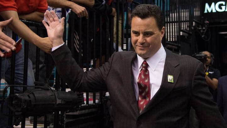 Arizona Wildcats head coach Sean Miller enters the