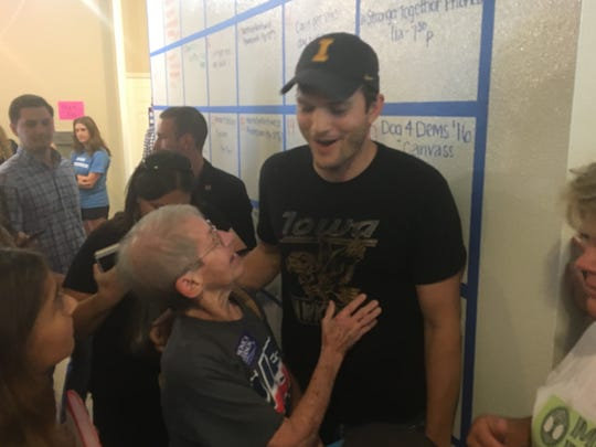 Ashton Kutcher chats with Elaine Arnold at a campaign event Saturday for Democratic presidential nominee Hillary Clinton in Cedar Rapids. Arnold worked with Kutcher's father for years at the General Mills plant in Cedar Rapids.