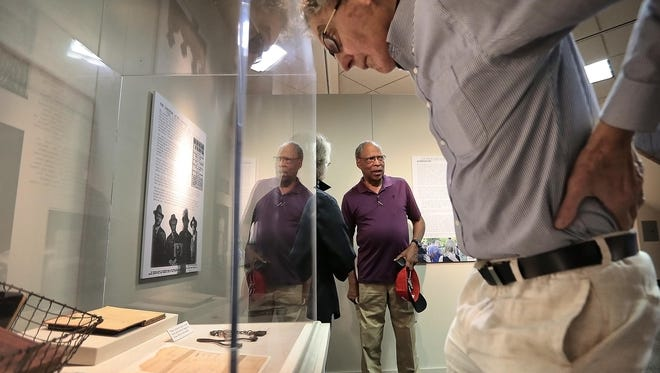 John Ashworth and Randall Mullins (right), two of the local leaders of the Memphis Lynching Sites Project, look a new exhibit for the first time at the Pink Palace detailing the 1917 lynching of Ell Persons.