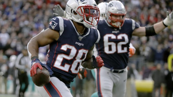 New England Patriots running back James White runs for a touchdown in the second half of an NFL football game, Sunday, Dec. 29, 2019, in Foxborough, Mass.