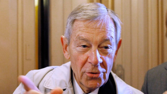 In a Tuesday, Dec. 7, 2010, file photo, Sen. George Voinovich, R-Ohio, speaks to reporters outside of the Senate Chamber on Capitol Hill in Washington. Voinovich, also a two-term Ohio governor, died Sunday, June 12, 2016. He was 79.