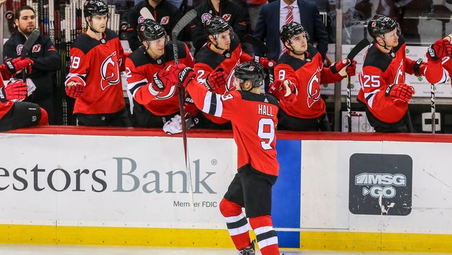 New Jersey Devils left wing Taylor Hall (9) celebrates with teammates after a goal against the Minnesota Wild during the first period at Prudential Center.