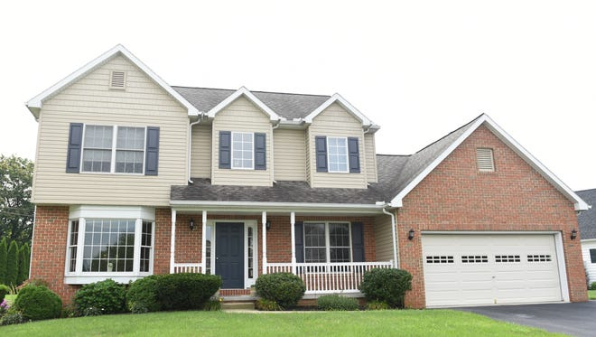 This traditional two-story house at 400 Millbridge Drive, Lebanon, is located in North Cornwall Township and the Cornwall-Lebanon School District. The house features three bedrooms, two full bathrooms, one half bathroom, patio, formal dining room, first-floor family room, laundry room, master bathroom, kitchen and garage. The house lists for $264,900. Its multilisting number is 247735.