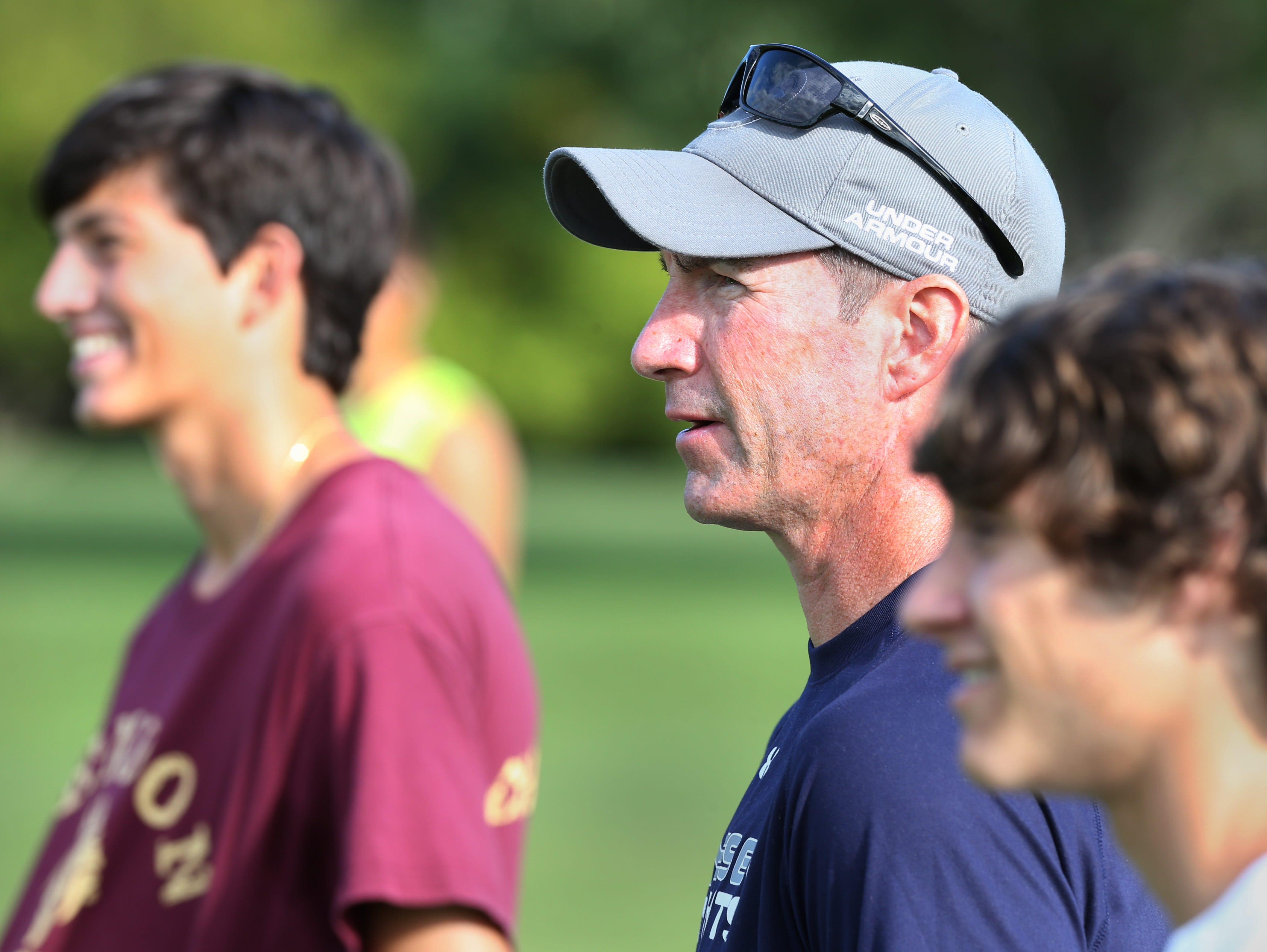 Pittsford Mendon boys varsity soccer coach Mark Hurley always keeps an eye on the action on the field during practice at Hopkins Park in Mendon Tuesday, Sept. 22, 2015.