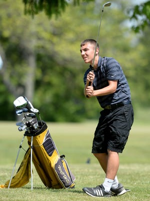 Winchester's Mason Melton watches his shot while playing golf in the TEC tournament Saturday, May 23, 2015, at Highland Lake Golf Course in Richmond.