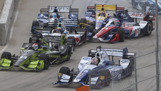 Racecars start the Chevrolet Detroit Belle Isle Grand Prix on June 5, 2016.