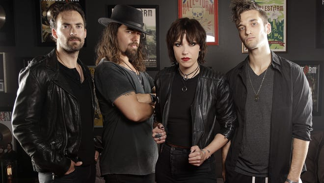 """In this July 20, 2018, photo, members of Halestorm, from left, Josh Smith, Joe Hottinger, Lzzy Hale, and Arejay Hale pose in Nashville, Tenn., to promote their new record, """"Vicious,"""" out on July 27. (AP Photo/Mark Humphrey)"""