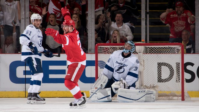 Detroit left wing Tomas Tatar celebrates a goal by teammate Andreas Athanasiou (not pictured) on Tampa Bay goalie Ben Bishop in the second period as the Red Wings beat the Lightning 2-0 in Game 3 of their first-round playoff series at Joe Louis Arena in Detroit.
