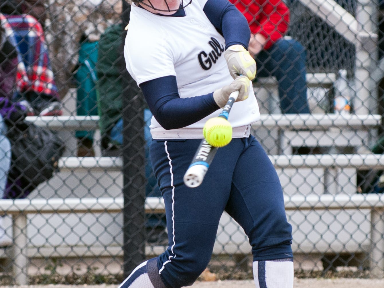 Gull Lake's Cassidy Eastman (11) drives on deep into center field for a base hit in the first game of the tournament.