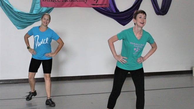 Laura Self, right, puts finishing touches on the line dances she'll be teaching at the upcoming appreciation for Alzheimer caregivers at Michele's Dance Academy.