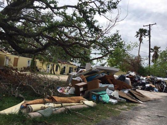 Debris lines streets in Rockport, Texas weeks after