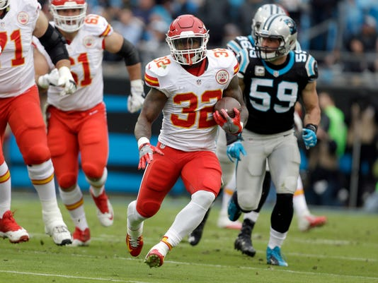 Kansas City Chiefs' Spencer Ware (32) runs past Carolina Panthers' Luke Kuechly (59) in the first half of an NFL football game in Charlotte, N.C., Sunday, Nov. 13, 2016. (AP Photo/Bob Leverone)