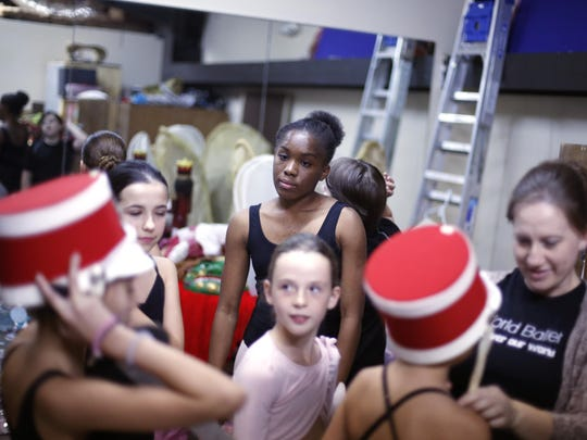 """Children gather their costumes during a rehearsal for their performance of the """"Nutcracker"""" at Tallahassee's World Ballet studio."""