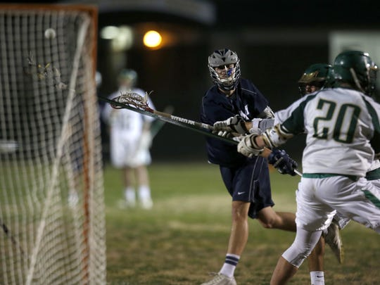 Maclay's Garritt Schwarz scores a goal on Lincoln during their game at Lincoln High School on Tuesday, Feb. 23, 2016.