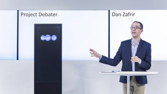 IBM Research's experimental artificial intelligence system, Project Debater, with debater Dan Zafrir.