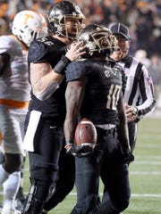 Vanderbilt offensive lineman Barrett Gouger (56) and wide receiver Trent Sherfield (10) celebrate Sherfield's big catch that led to a Commodores touchdown in the fourth quarter against Tennessee on Nov. 26, 2016.