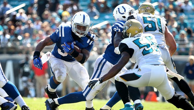 Indianapolis Colts Trent Richardson looks for running room in the Jaguars defense. The Indianapolis Colts defeated the Jacksonville Jaguars 44-17 Sunday, September 21, 2014, afternoon at EverBank Field in Jacksonville FL.