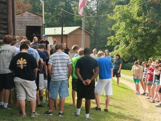 Campers meet each morning to recite the Pledge of Allegiance