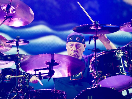 Rush drummer Neil Peart entertains the crowd at US Airways Center July 27, 2015.
