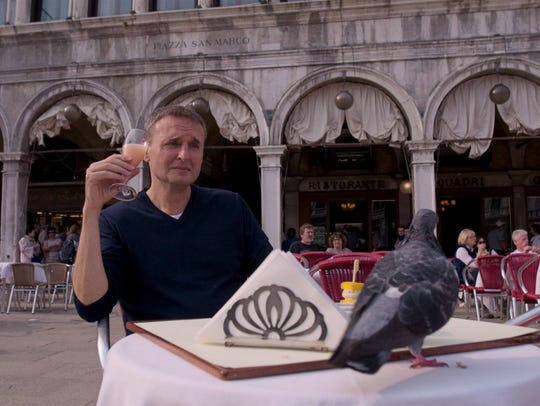 Phil Rosenthal shares a Venice table with a fowl guest