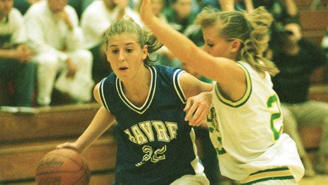 Loree Payne drives to the basket against CMR defender Kayci Kottke on Sept. 29, 1998 at CMR Fieldhouse. Payne scored 39 points as Havre defeated Russell 69-61.