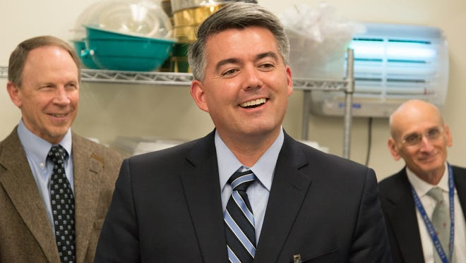 Colorado Senator Cory Gardner listens during a visit to a lab at the Center for Disease Control office in Fort Collins on Feb. 12.