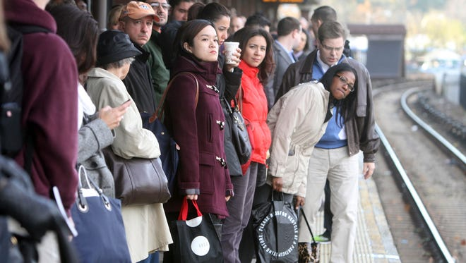 Commuters wait for a New York City-bound Metro-North train in at the White Plains station.