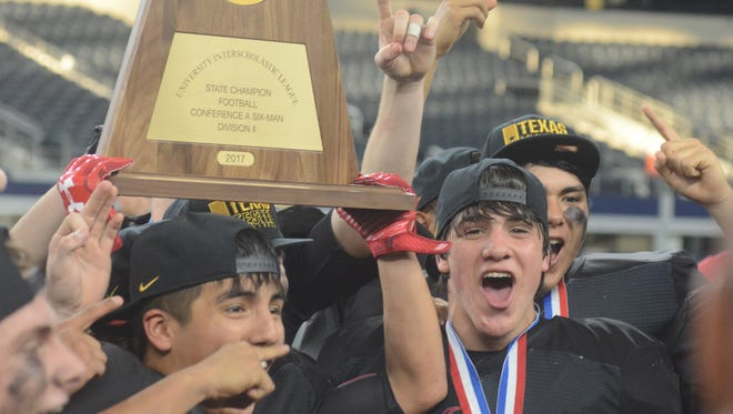 Strawn players celebrate with the state championship trophy after the Greyhounds' 78-42 win over Balmorhea in the Class 1A Division II state title game Wednesday at AT&T Stadium in Arlington.