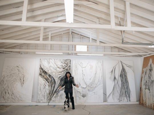 Angel Chen with her dog, Romeo, in her studio in Joshua Tree