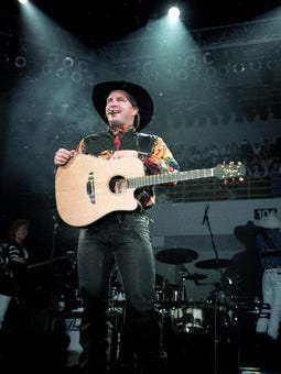 Garth Brooks is shown in this file photo from November 1992, his last performance in the Cajundome in Lafayette, Louisiana.