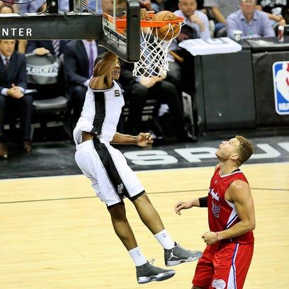 Spurs forward Kawhi Leonard dunks for a basket on a