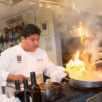 Chef Mel Mecinas cooking
