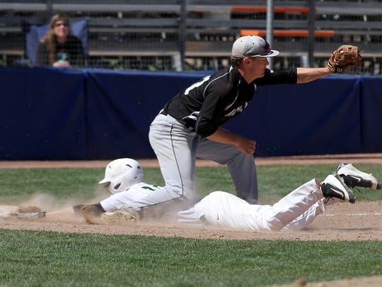 Farmington's Dominic Martinez slides under Albuquerque