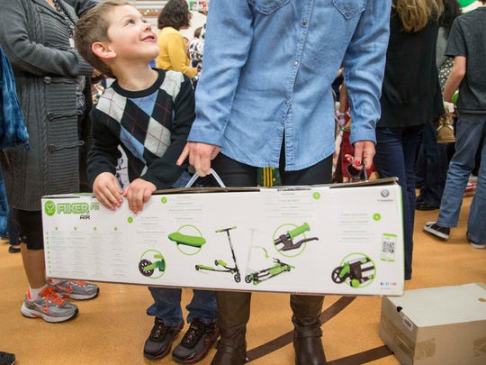 Jacob Markwell,10, got a scooter as christmas gift  from Walmart and the Today show to Sunshine Acres Children's Home in Mesa, Az., on Dec. 19, 2014.   ****Story embargoed until Dec. 23-24 PLEASE TALK TO MEGAN FINNERTY