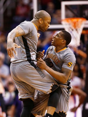 P.J. Tucker and Eric Bledsoe celebrate during their overtime victory against the Oklahoma City Thunder during NBA action on Thursday, Feb. 26, 2015 in Phoenix.
