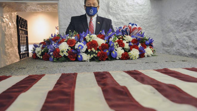 Quincy Mayor Thomas Koch pauses at the crypt of President John Adams adorned with a Presidential Wreath honoring his 285th birthday during a ceremony at the United First Parish Church in Quincy, Friday, Oct. 30, 2020. Tom Gorman/For The Patriot Ledger