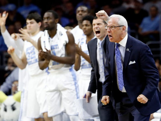 North Carolina coach Roy Williams and players react during the second half of the team's college basketball game against Indiana in the regional semifinals of the men's NCAA Tournament, early Saturday, March 26, 2016, in Philadelphia. (AP Photo/Matt Rourke)