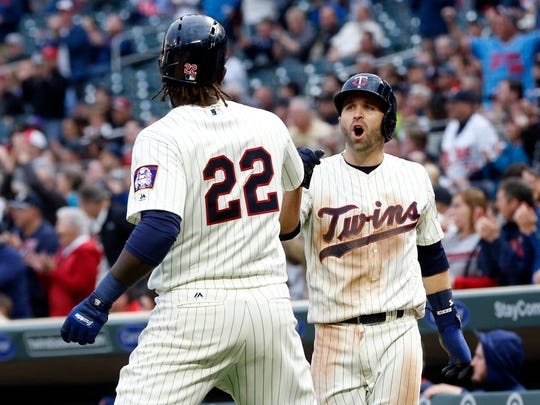 Minnesota Twins' Brian Dozier, right, celebrates with
