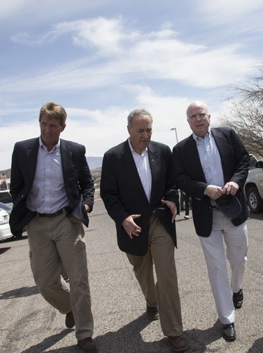 Sens. Jeff Flake (from left), R-Ariz., Charles Schumer, D-N.Y., John McCain, R-Ariz., and Michael Bennet, D-Colo., gathered for a press conference at Santa Cruz County Complex in Nogales, Arizona, on March 27, 2013, after they took a tour of the U.S.-Mexico border.