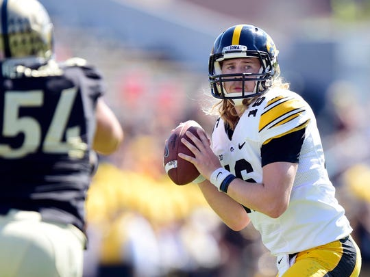 C.J. Beathard is shown during his first career start, Sept. 27, 2014, against Purdue. He won the game, 24-10, but wouldn't start again that season and served as the backup to Jake Rudock. Beathard has since cut his long hair and owns a 21-6 career record as an Iowa starter.